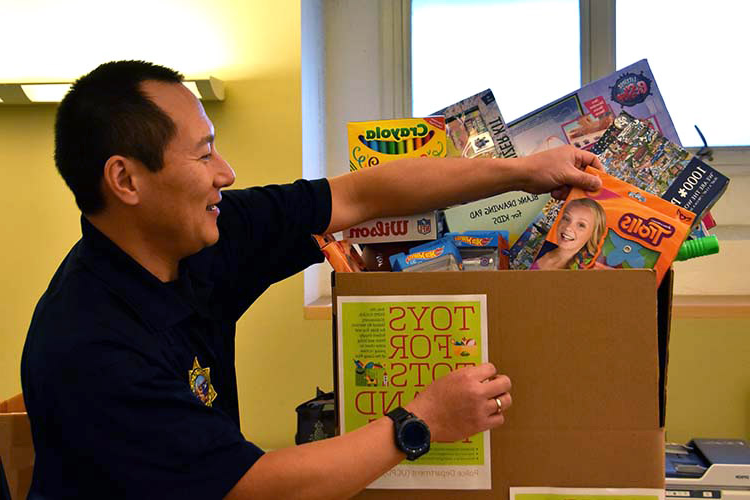 Alex Yao, 民主联盟 captain, with toys, schools supplies headed for Butte County fire victims